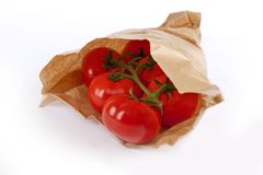 Tomatoes in paper bag Royalty Free Stock Photography