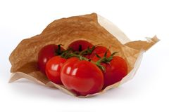 Tomatoes in paper bag Royalty Free Stock Images