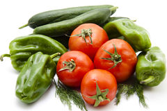Tomatoes with paprika and cucumbers Stock Images