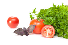 Tomatoes and parsley. On a white background Royalty Free Stock Photo