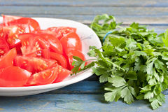 Tomatoes and parsley Royalty Free Stock Image