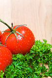 Tomatoes and parsley on countertop. Tomatoes and parsley - wet close on kitchen countertop Stock Image