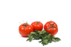 Tomatoes with parsley Stock Photo