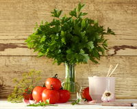 Tomatoes and parsley Stock Photos