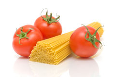 Tomatoes and pasta closeup on white background Stock Photos