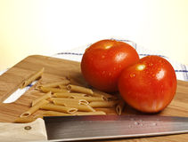 Tomatoes pasta and knife Royalty Free Stock Image