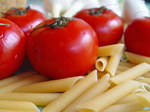Tomatoes, pasta, onion Stock Photography