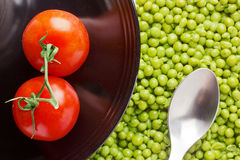 Tomatoes and Peas Stock Images