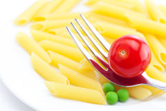 Tomatoes, peas, pasta and fork Royalty Free Stock Image