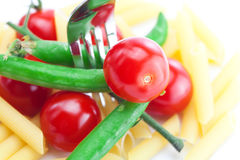 Tomatoes, peas, pasta and fork Royalty Free Stock Photo