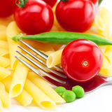 Tomatoes, peas, pasta and fork Stock Image