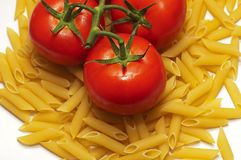 Tomatoes and penne stock photos