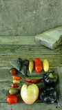 Tomatoes and pepers. Tomatoes, cucumbers and chili on rocks and wooden floor Stock Photo