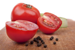 Tomatoes with  pepper. Tomatoes with fragrant pepper close up Stock Photos