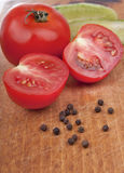 Tomatoes with pepper. Tomatoes with fragrant pepper close up Royalty Free Stock Photography