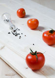 Tomatoes and pepper. Fresh tomatoes on a wooden board Stock Images