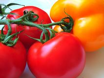 Tomatoes and a pepperbell Royalty Free Stock Photos