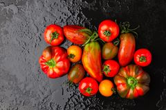 Tomatoes and peppers on a black background Royalty Free Stock Image