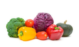 Tomatoes, peppers, broccoli, pumpkin and red cabbage isolated on Stock Photos