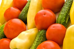 Tomatoes peppers and cucumbers. Colorful fresh group of vegetables for background stock image