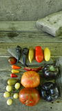 Tomatoes and peppers 5. Tomatoes, cucumbers and chili on rocks and wooden floor Stock Photo