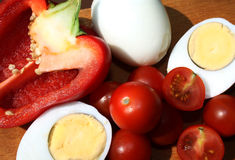 Tomatoes, peppers and eggs. Still life of tomatoes, peppers and hard-boiled eggs royalty free stock photos