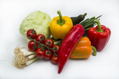 Tomatoes, peppers, onions, cabbage and cucumber lying on white background Royalty Free Stock Photography