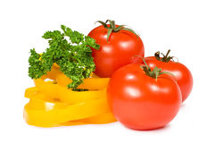 Tomatoes, peppers and parsley Stock Images