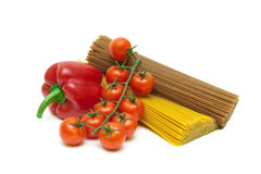 Tomatoes, peppers and pasta isolated on white background Stock Photography