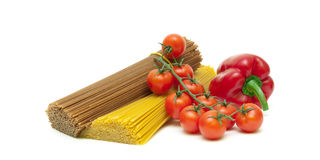 Tomatoes, peppers and pasta isolated on white background Stock Photo
