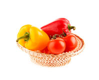 Tomatoes and peppers in a wicker basket Royalty Free Stock Image