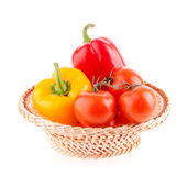 Tomatoes and peppers in a wicker basket Royalty Free Stock Photography