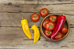 Tomatoes and peppers in a bowl Stock Photography