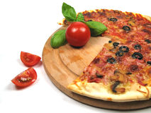 Tomatoes and pizza. Pizza with some tomatoes fallen of the plate Stock Photography