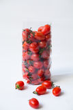 Tomatoes in plastic bag Stock Images