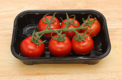 Tomatoes in a plastic tray Royalty Free Stock Photos