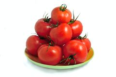 Tomatoes on a plate Royalty Free Stock Images
