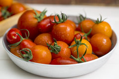 Tomatoes on a plate. Close-up royalty free stock photos