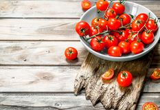 Tomatoes on a plate on a cutting Board. On wooden background stock photos
