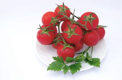Tomatoes on plate Royalty Free Stock Images