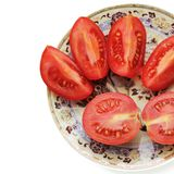 Tomatoes on a plate on a white background stock image