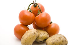 Tomatoes with potatoes. Fresh shrub tomatoes and potatoes Royalty Free Stock Photography