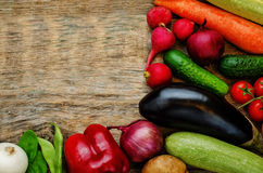 Tomatoes, potatoes, eggplant, zucchini, onion, carrot, radish, c. Wood background with vegetables. the toning. selective focus Stock Image