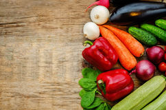 Tomatoes, potatoes, eggplant, zucchini, onion, carrot, radish, c. Wood background with vegetables. the toning. selective focus Stock Photography