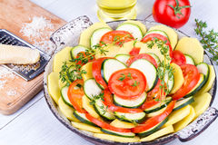 Tomatoes, potatoes and zucchini prepared for bake. Stock Images