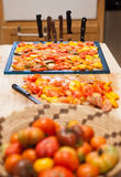 Tomatoes prepared for drying. Heirloom tomatoes on a drying rack ready for a dehydrator Royalty Free Stock Image