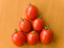 Tomatoes pyramid. Small pyramid made of tomatoes. Up view Royalty Free Stock Image