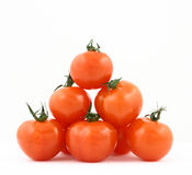 Tomatoes' pyramid. Some cherry tomatoes put together in some kind of pyramid or a triangle royalty free stock image