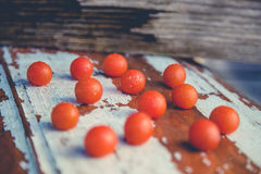 Tomatoes in the rain on the wooden background Royalty Free Stock Photography