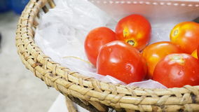 Tomatoes in the rattan basket Stock Images